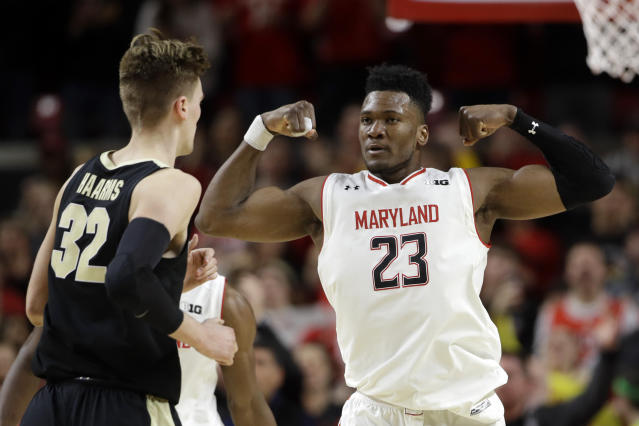 Maryland forward Bruno Fernando (23) gestures in front of Purdue center Matt Haarms during the second half of an NCAA college basketball game Tuesday, Feb. 12, 2019, in College Park, Md. Fernando contributed 12 points to Maryland's 70-56 win. (AP Photo/Patrick Semansky)