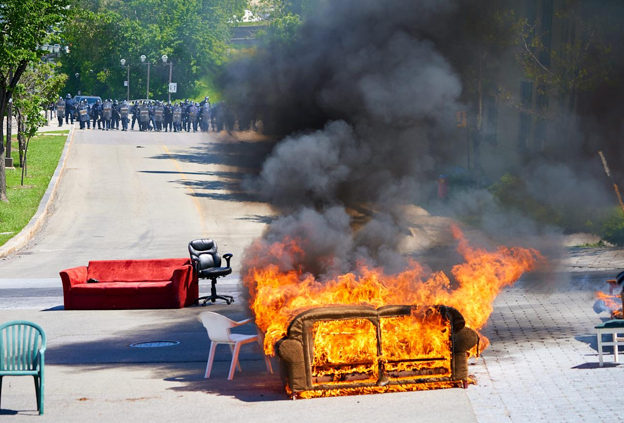 <p>Protesters light a couch on fire in during protests at the G7 Summit in Quebec City on 08 June 2018. EPA/ANDRE PICHETTE </p>