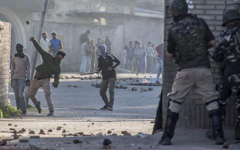 Clashes erupted in Srinigar, the summer capital of Indian administered Kashmir, following the rape and murder - Credit: Getty Images/Yawar Nazir