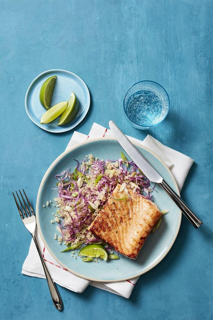"<p>Glazed, broiled salmon sits on a bed of fluffy quinoa in this sweet and savory fish recipe.</p><p><a href=""https://www.womansday.com/food-recipes/food-drinks/recipes/a56926/honey-spiced-salmon-with-quinoa-salad-recipe/"" rel=""nofollow noopener"" target=""_blank"" data-ylk=""slk:Get the recipe."" class=""link rapid-noclick-resp""><strong>Get the recipe.</strong></a></p>"