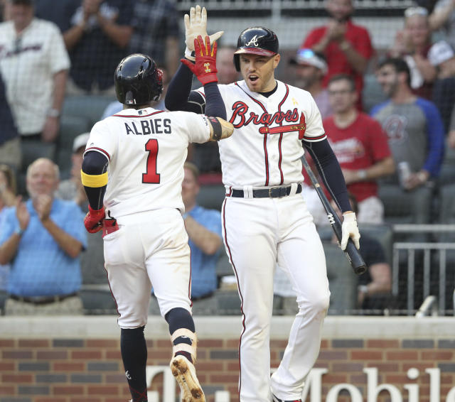 Atlanta Braves Ozzie Albies, left, celebrates with teammate Freddy Freeman after hitting a solo home run against the Washington Nationals during the first inning of a baseball game Saturday, Sept. 7, 2019, in Atlanta. (AP Photo/Tami Chappell)