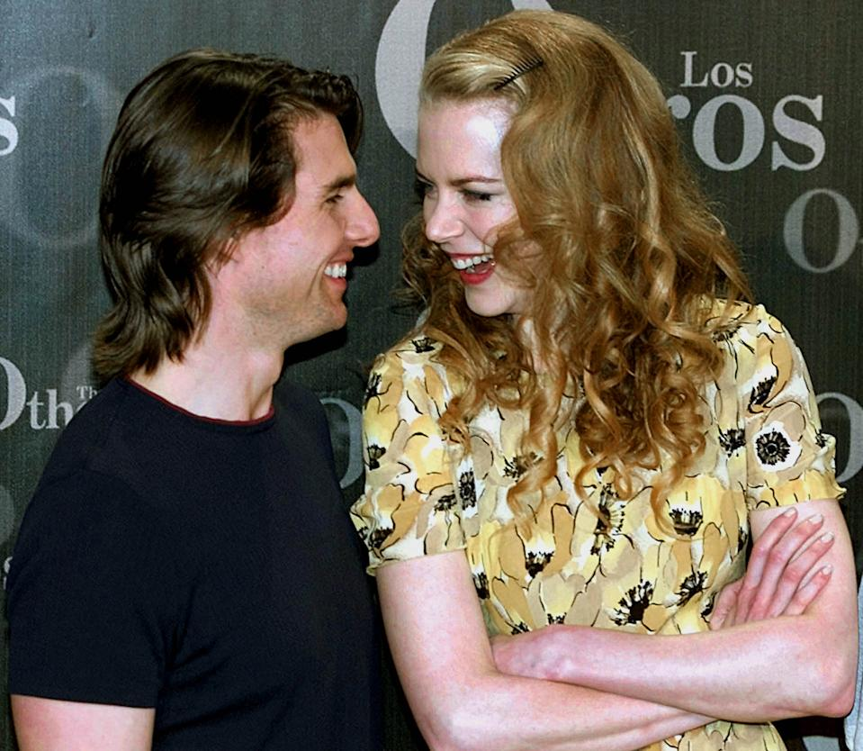 "Actor Tom Cruise (L) and wife, Australian actress Nicole Kidman (R), are ending their 10-year marriage, according to a statement released February 5, 2001 by their spokeswoman Pat Kingsley. The couple, pictured July 26, 2000 at a photocall in Madrid during the filming of ""The Others,"" starring Kidman and co-produced by Cruise, have two adopted children.    BK/RCS"