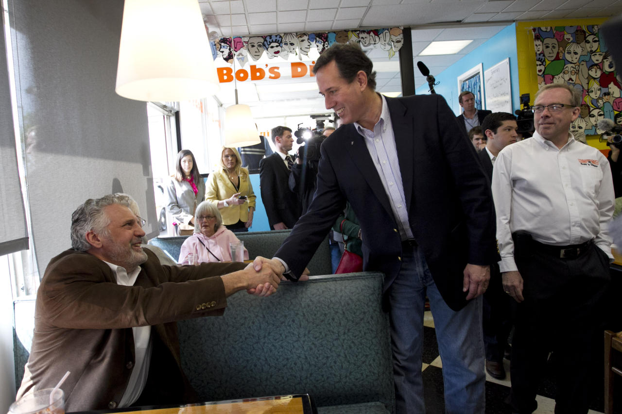 Republican presidential candidate, former Pennsylvania Sen. Rick Santorum shakes hands with a patron at Bob's Diner in Carnegie, Pa., Wednesday, April 4, 2012. (AP Photo/Jae C. Hong)