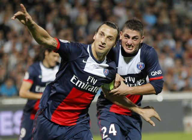Paris Saint Germain's Zlatan Ibrahimovic (C) celebrates with teammate Marco Verratti after scoring a penalty during their French Ligue 1 soccer match against Olympique Marseille at the Velodrome stadium in Marseille, October 6, 2013. REUTERS/Jean-Paul Pelissier (FRANCE - Tags: SPORT SOCCER)