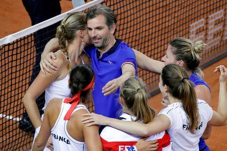 Tennis - Fed Cup - World Group Semi-Final - France v Romania - Kindarena, Rouen, France - April 21, 2019 Captain Julien Benneteau celebrates victory in the semi-final with team mates REUTERS/Charles Platiau