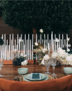 """<p>Make a statement when celebrating outside by using candlesticks as a runner <em>and</em> centerpiece. Varied heights add dimension, while the glow sets the tone for your dinner. Bonus: A long candlestick holder like this one from <a href=""""https://www.instagram.com/p/COfo_pmML_N/"""" rel=""""nofollow noopener"""" target=""""_blank"""" data-ylk=""""slk:Shamaa Co."""" class=""""link rapid-noclick-resp"""">Shamaa Co.</a> keeps setup easy.</p>"""