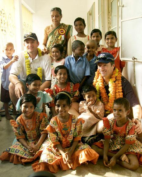 Mark and Steve Waugh of Australia meet some of the residents of Udayan Resurection Home, Steve Waugh patroned the girls wing of the home, which educates and cares for the children of Leprosy sufferers, Barrack Pore, Calcuuta, India. X DIGITAL IMAGE  Mandatory Credit: Hamish Blair/ALLSPORT