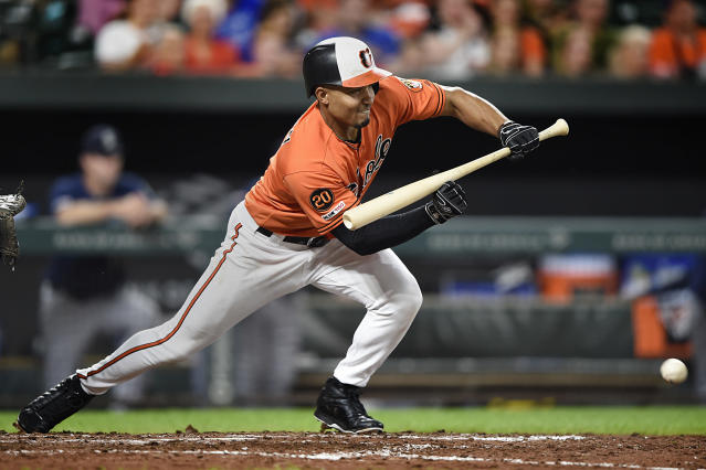 Baltimore Orioles' Richie Martin bunts for a single against the Seattle Mariners in the fifth inning of a baseball game, Saturday, Sept. 21, 2019, in Baltimore. (AP Photo/Gail Burton)