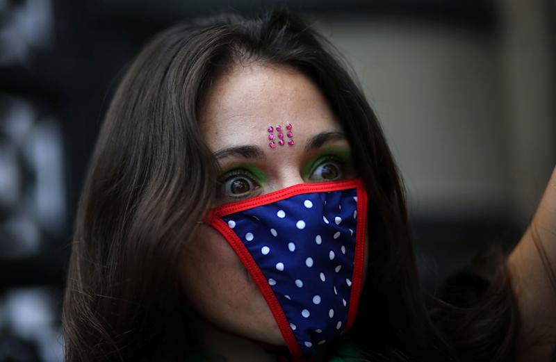 A woman wears knickers as a mask during a demonstration on International Women's Day.