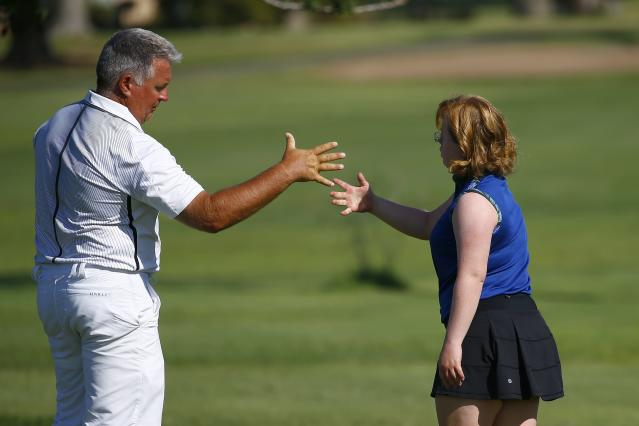"In this Aug. 28, 2019, photo, Amy Bockerstette, right, gets a high-five from her swing coach, Matt Acuff, at Palmbrook Country Club in Sun City, Ariz. ""So many people could learn so many lessons just from how she lives her life,"" Acuff said. ""The abundance she lives her life and the joy she gets out of, if we all live like that, we'd be far better off."" (AP Photo/Ross D. Franklin)"
