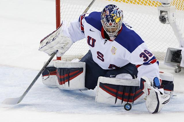 USA goaltender Ryan Miller stops a shot on the goal during the 2014 Winter Olympics men's ice hockey game against Slovenia at Shayba Arena Sunday, Feb. 16, 2014, in Sochi, Russia