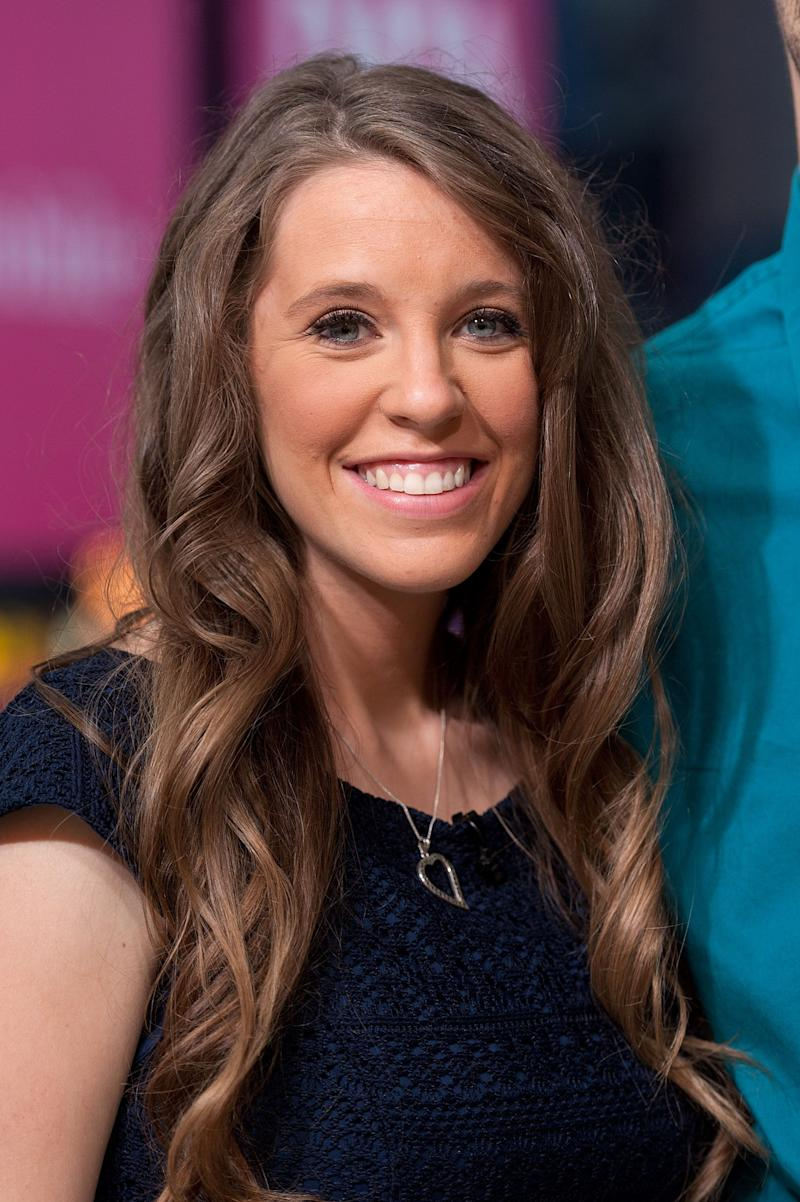 Jill Duggar has a passionate and attractive smile on her face as she poses for the camera
