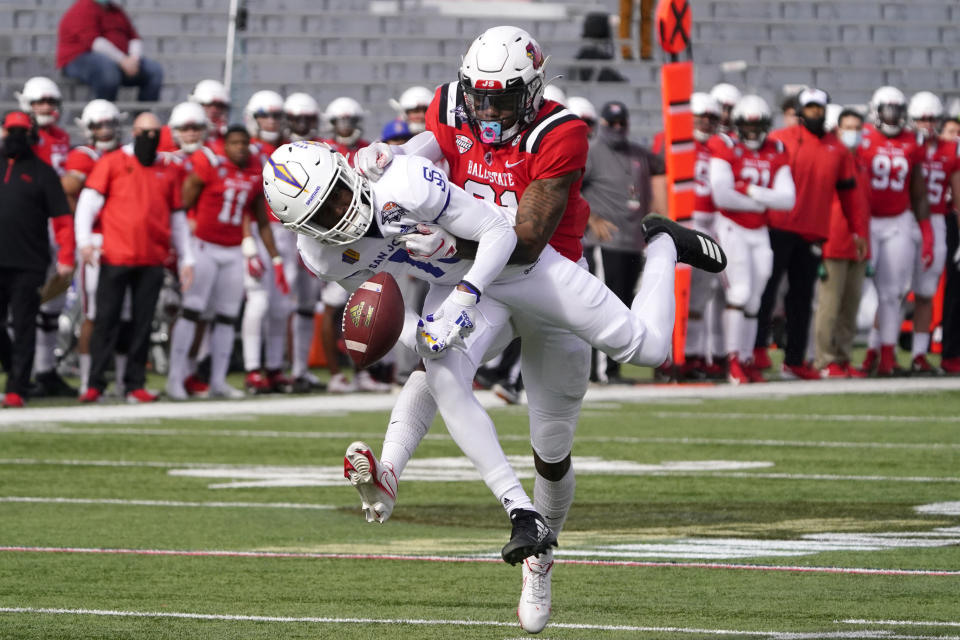 Ball State cornerback Antonio Phillips defends against a pass intended for San Jose State wide receiver Jermaine Braddock (13) in the first half of the Arizona Bowl NCAA college football game, Thursday, Dec. 31, 2020, in Tucson, Ariz. (AP Photo/Rick Scuteri)