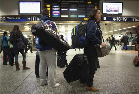 Travelers walk through Penn Station in New York, November 26, 2013. REUTERS/Carlo Allegri