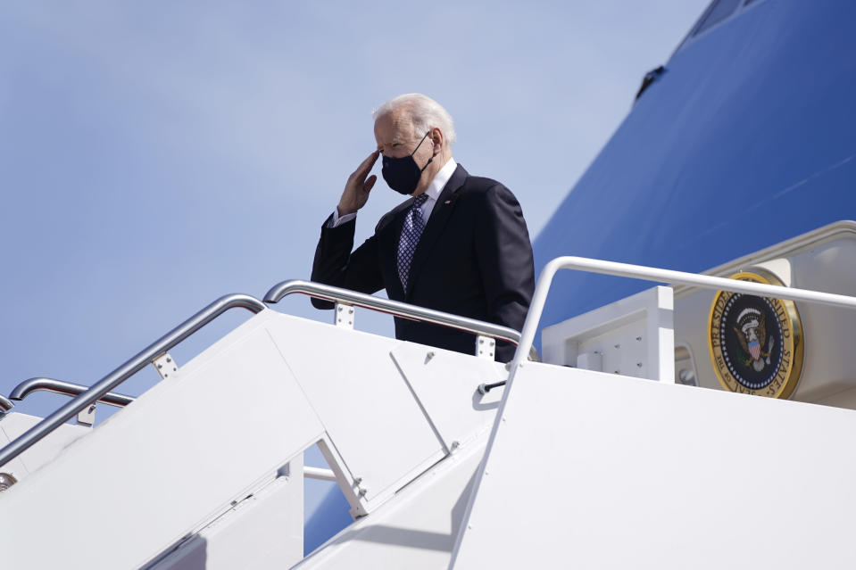 President Joe Biden boards Air Force One at Andrews Air Force Base, Md., Friday, March 19, 2021. Biden is en route to Georgia. (AP Photo/Patrick Semansky)