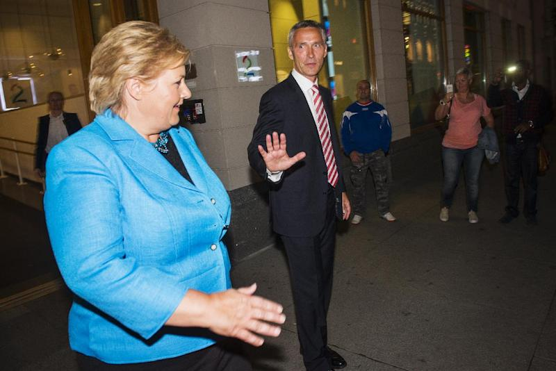 Norway`s Prime Minister Jens Stoltenberg , right, and main opposition leader Erna Solberg leave the building after an appearance in a TV show in Oslo Sunday night, Sept. 8, 2013. Norway holds general elections on September 8 and 9. (AP Photo / Fredrik Varfjell, NTB scanpix)