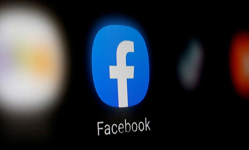 FILE PHOTO: FILE PHOTO: A Facebook logo is displayed on a smartphone in this illustration