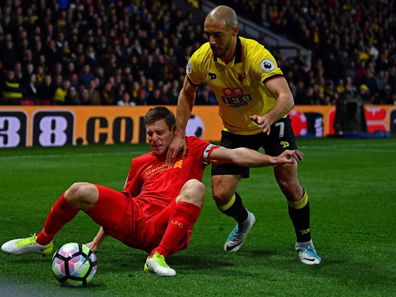 James Milner struggles under pressure from Nordin Amrabat