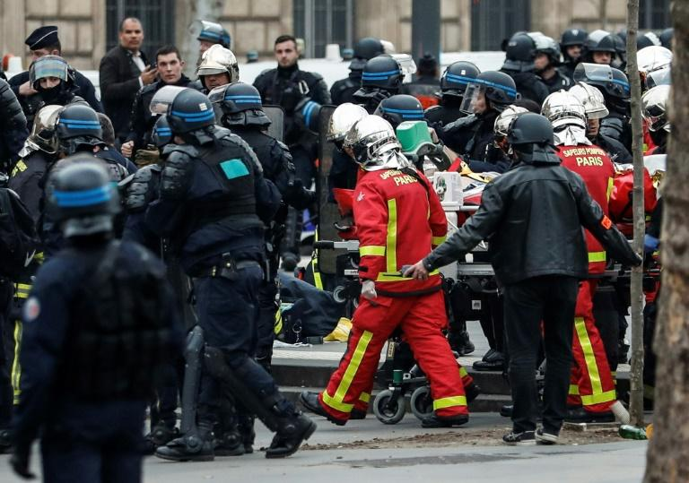 A police officer suffered a heart attack during the demos and was taken to hospital in serious condition