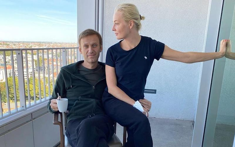 Alexei Navalny, pictured with his wife Yulia, has been convalescing in a Berlin hospital since late August when he evacuated from Siberia - Handout/EPA-EFE