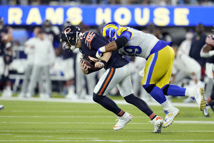 FILE - In this Sunday, Sept. 12, 2021, file photo, Chicago Bears quarterback Andy Dalton is hauled down by Los Angeles Rams defensive end Aaron Donald during the second half of an NFL football game in Inglewood, Calif. As Donald, now 30, closes in on the franchise's career sacks record this week, the three-time NFL Defensive Player of the Year says the only difference in his game with age is the recovery time necessary for minor injuries. (AP Photo/Marcio Jose Sanchez, File)