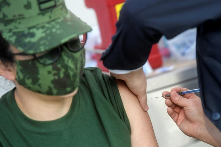 A Mexican military medical receives the Pfizer/BioNTech Covid-19 vaccine jab, at the General Hospital in Mexico City, on December 24, 2020