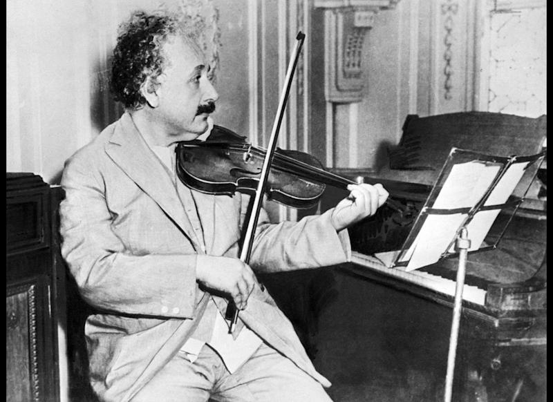 PRINCETON, UNITED STATES: (FILES) Picture taken in Princeton in 1931 of German-born Swiss-US physicist Albert Einstein (1879-1955), author of theory of relativity, awarded the Nobel Prize for Physics in 1921, playing the violin. Germany, the birthplace of Albert Einstein, launches 19 January 2005 a year of international celebrations to mark the 100th anniversary of three of the physicist's four papers that changed the way we view the Universe. AFP PHOTO/FILES (Photo credit should read -/AFP/Getty Images)