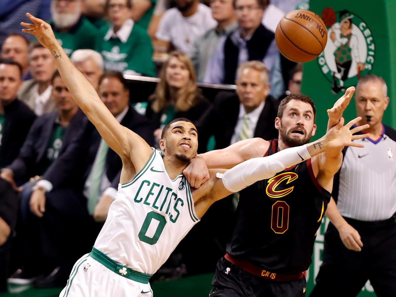May 23, 2018; Boston, MA, USA; Cleveland Cavaliers center Kevin Love (0) and Boston Celtics forward Jayson Tatum (0) reach for a rebound during the first quarter of game five of the Eastern conference finals of the 2018 NBA Playoffs at TD Garden. Mandatory Credit: Winslow Townson-USA TODAY Sports     TPX IMAGES OF THE DAY