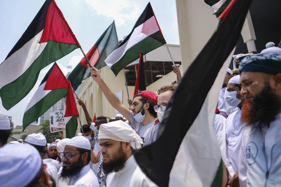 Bangladeshi Muslims protesting against Israeli attacks on Palestinians in Gaza, gather after Eid al-Fitr prayers in front of Baitul Mukarram Mosque and wave Palestinian and Bangladeshi flags in Dhaka, Bangladesh, Friday, May 14, 2021. (AP Photo/Mahmud Hossain Opu)