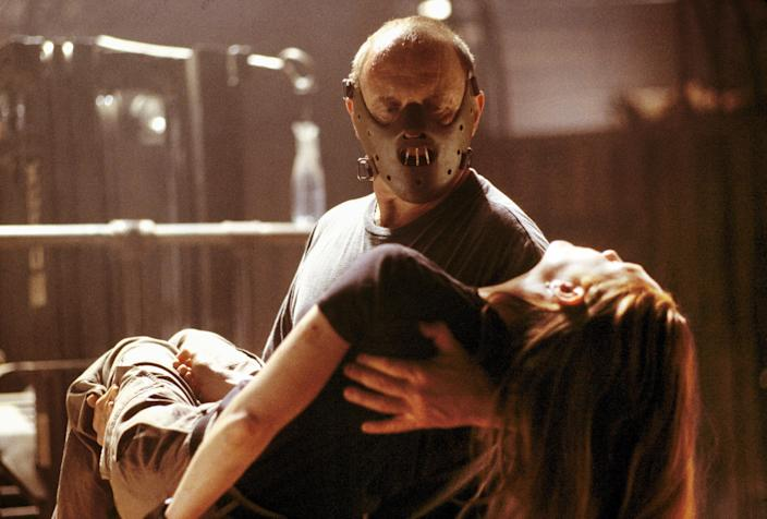 """Hannibal (Anthony Hopkins, left) carries an unconscious Clarice (Julianne Moore) in 2001 movie """"Hannibal."""""""