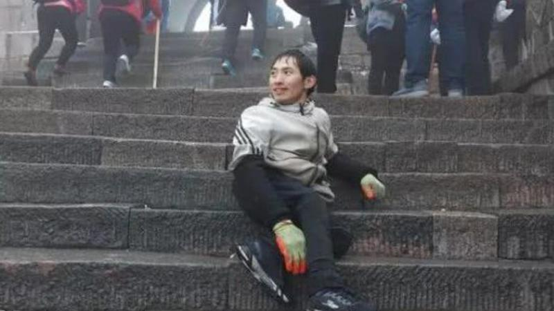 Chinese man defies the polio that paralysed his legs with overnight climb through snow on Mount Tai