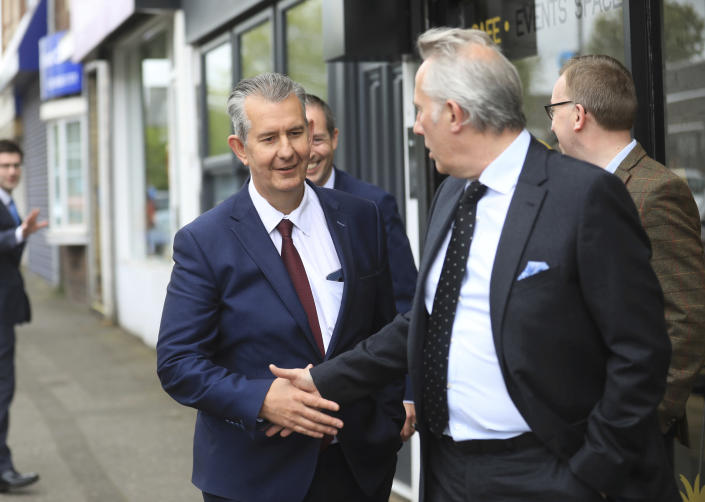 Democratic Unionist Party members Edwin Poots, left, is greeted by Ian Paisley jnr outside party headquarters in east Belfast after voting took place to elect a new leader on Friday May 14, 2021. Edwin Poots and Jeffrey Donaldson are running to replace Arlene Foster. (AP Photo/Peter Morrison)