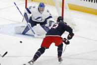 Tampa Bay Lightning's Andrei Vasilevskiy, top, of Russia, makes a save against Columbus Blue Jackets' Alexandre Texier, of France, during the second period of an NHL hockey game Saturday, Jan. 23, 2021, in Columbus, Ohio. (AP Photo/Jay LaPrete)
