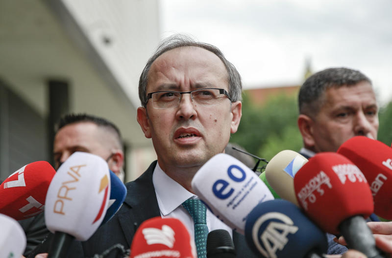 Newly elected prime minister Avdullah Hoti, speaks to the media, in the capital Pristina, Wednesday, June 3, 2020. Kosovo's parliament voted in a new prime minister Wednesday to lead a fragile coalition government that will inherit the economic impact of the coronavirus pandemic and stalled normalization talks with neighboring Serbia. (AP Photo/Visar Kryeziu)