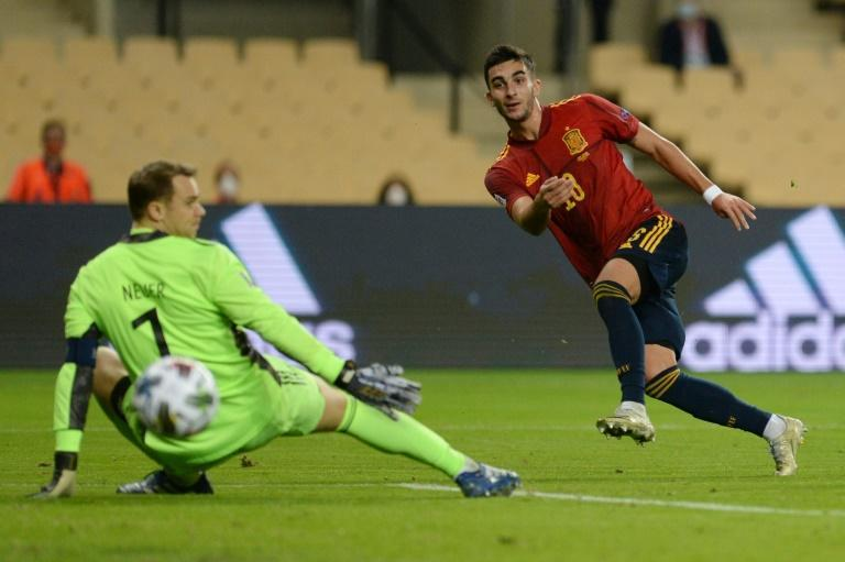 On the rise: Ferran Torres hit a hat-trick past Germany's Manuel Neuer