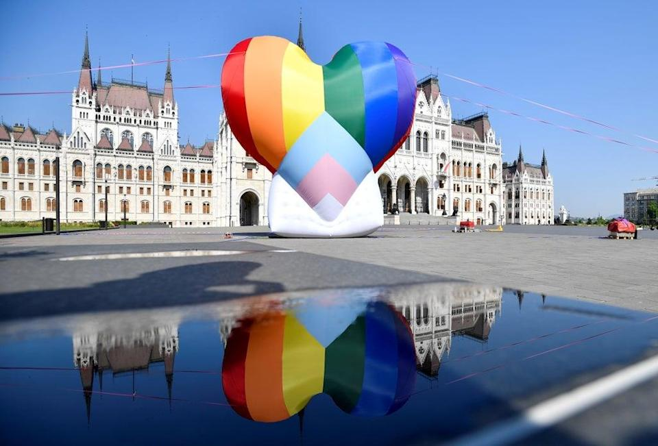 A huge rainbow balloon put up at Hungary's parliament in protest against anti-LGBT law.  (REUTERS)