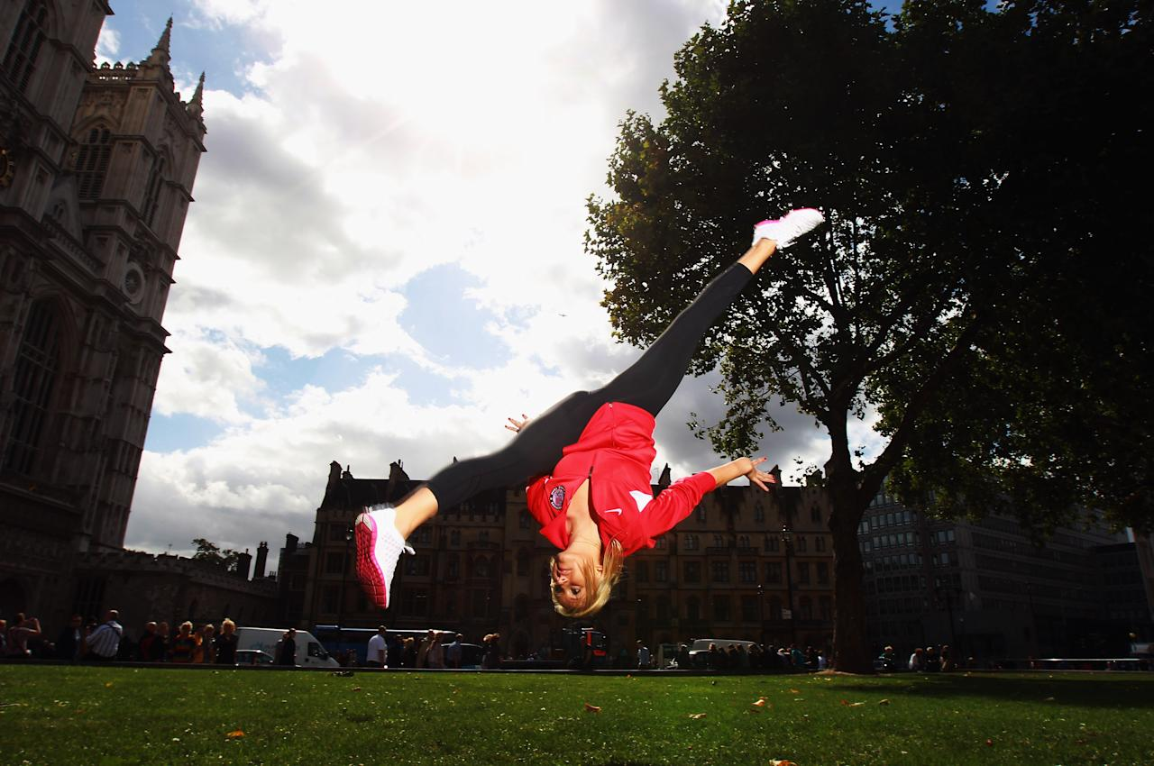 LONDON, ENGLAND - SEPTEMBER 13:  Gymnast Nastia Liukin of the USA poses in front of Westminster Abbey during a tour of London on September 13, 2011 in London, England.  (Photo by Bryn Lennon/Getty Images for USOC)
