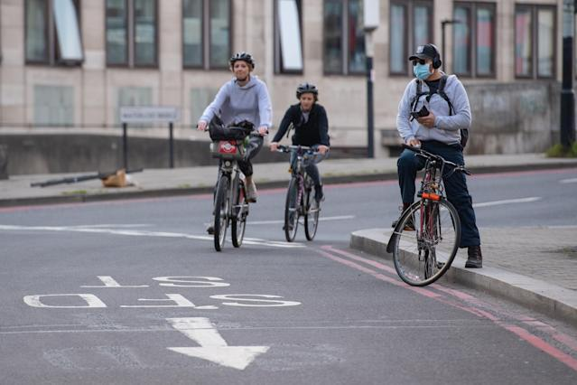 Cyclists ride in Waterloo in London as the UK continues its lockdown to help curb the spread of the coronavirus. (PA)