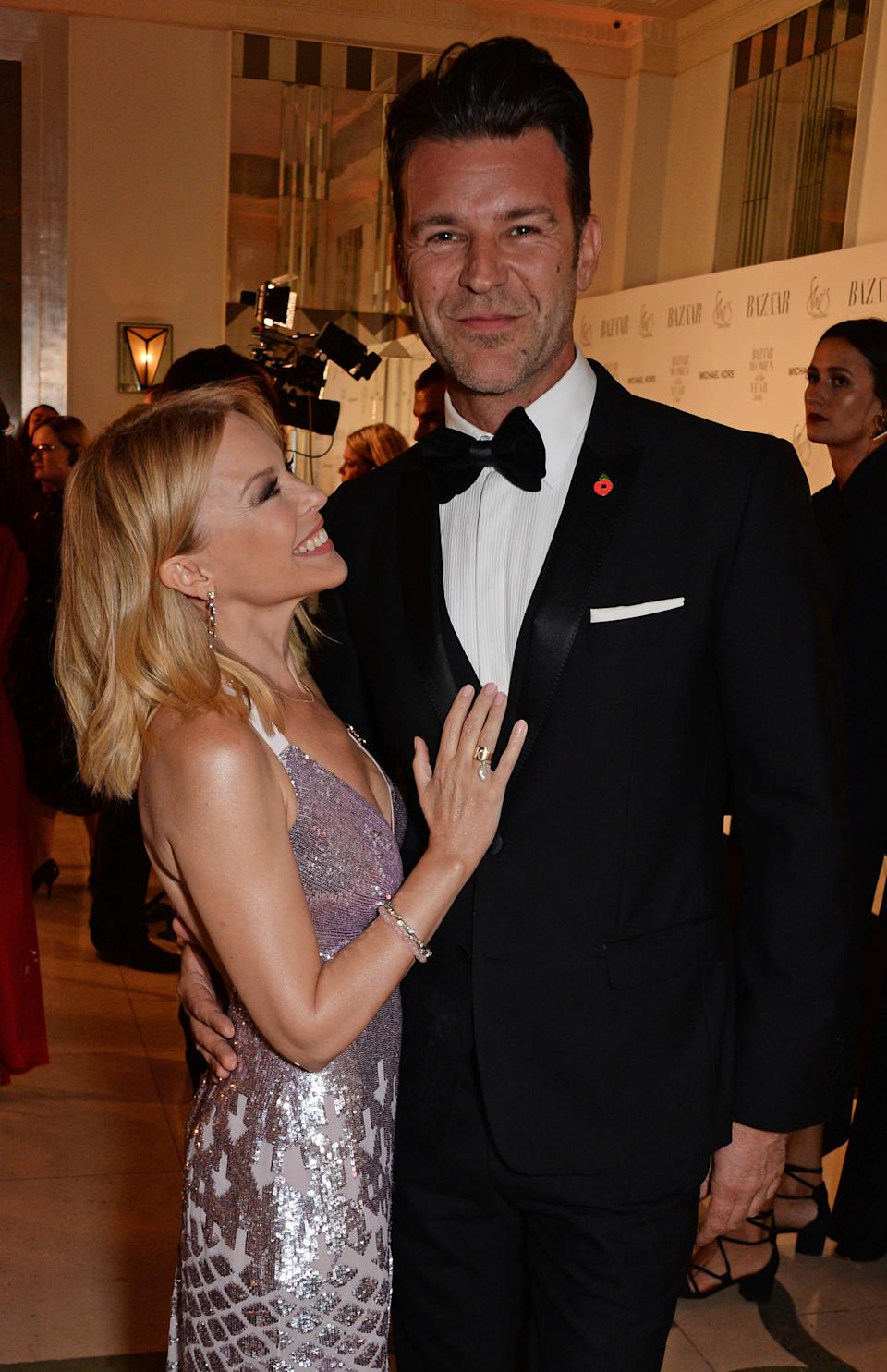 Kylie Minogue and Paul Solomons attend the Harper's Bazaar Women Of The Year Awards 2018 at Claridge's Hotel on October 30, 2018 in London, England