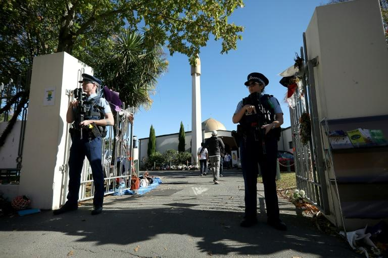 Armed New Zealand police officers guard the Al Noor mosque during Friday prayers in Christchurch in May 2019, just weeks after the March 15 shootings that killed 51 people (AFP Photo/Sanka VIDANAGAMA)
