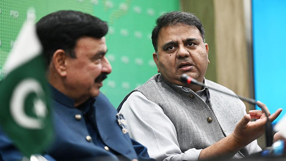 Pakistan Information Minister Fawad Chaudhry, pictured here speaking next to Interior Minister Sheikh Rashid Ahmed.