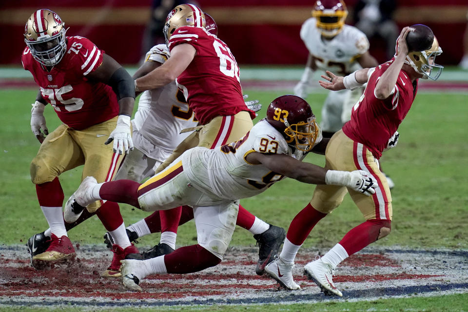 FILE - Washington Football Team defensive tackle Jonathan Allen (93) tries to tackle San Francisco 49ers quarterback Nick Mullens (4) during the second half of an NFL football game in Glendale, Ariz., in this Sunday, Dec. 13, 2020, file photo. Washington signed star defensive tackle Jonathan Allen on the eve of training camp to a $72 million, four-year contract extension with a $30 million signing bonus. Allen's agency, Team IFA, announced the terms of the deal in a Twitter post Monday, July 26, 2021. (AP Photo/Ross D. Franklin, File)