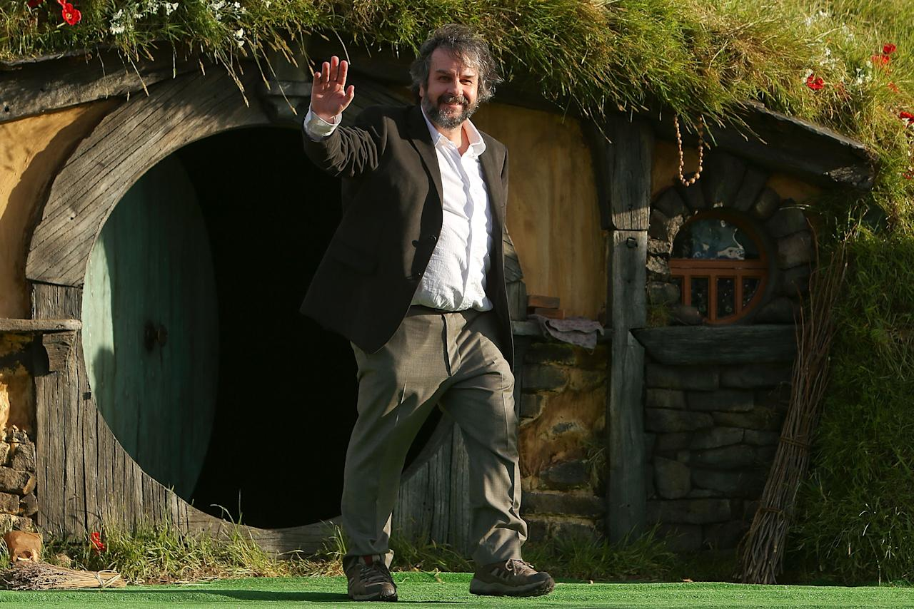 "WELLINGTON, NEW ZEALAND - NOVEMBER 28:  Director Sir Peter Jackson emerges from from a Hobbit house before delivering a speech at the ""The Hobbit: An Unexpected Journey"" World Premiere at Embassy Theatre on November 28, 2012 in Wellington, New Zealand.  (Photo by Hagen Hopkins/Getty Images)"