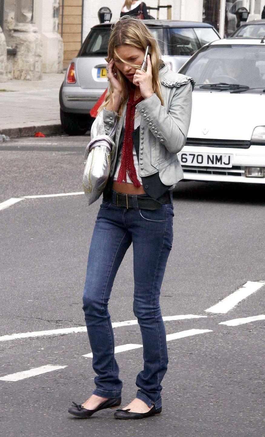 <p>Kate Moss shopping in London, making it cool to have a bunched hemline on your jeans, and then pair it with ballet flats.</p>