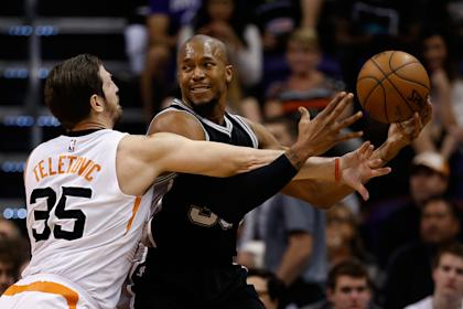 David West (right) averaged 7.1 points for the Spurs last season. (Getty Images)