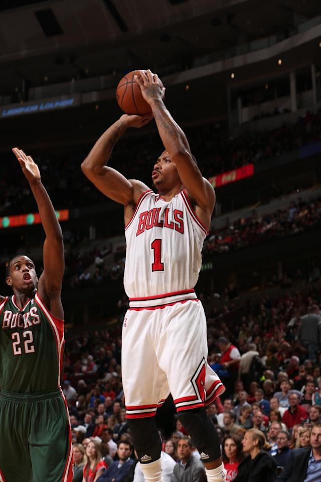 CHICAGO, IL - OCTOBER 21: Derrick Rose #1 of the Chicago Bulls shoots the ball against the Milwaukee Bucks during the NBA preseason game on October 21, 2013 at the United Center in Chicago, Illinois. (Photo by Gary Dineen/NBAE via Getty Images)