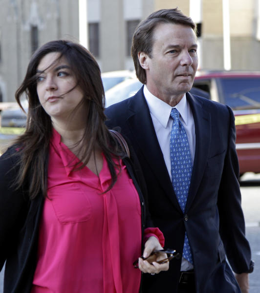 Former presidential candidate and U.S. Sen. John Edwards, right, arrives outside federal court with his daughter Cate, left, in Greensboro, N.C., for his trial on charges of violating federal campaign finance laws, Monday, April 23, 2012. Opening statements were to begin Monday. Edwards, 58, pleaded not guilty to six criminal counts related to nearly $1 million in secret payments from two wealthy supporters. Much of the money was used to hide the then-married politician's pregnant mistress during his 2008 White House campaign. (AP Photo/Chuck Burton)
