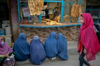 While the country's new rulers have not issues a formal policy outright banning women from working, directives by individual officials have amounted to their exclusion from the workplace (AFP/BULENT KILIC)