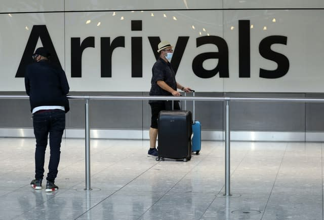Passengers at Heathrow after people returning from Spain were told they must quarantine when they return home