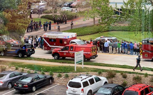 PHOTO: Police and students are seen outside STEM School Highlands Ranch, a charter middle school in the Denver suburb of Highlands Ranch, Colo., after a shooting, May 7, 2019. (Courtney Harper/AP, FILE)